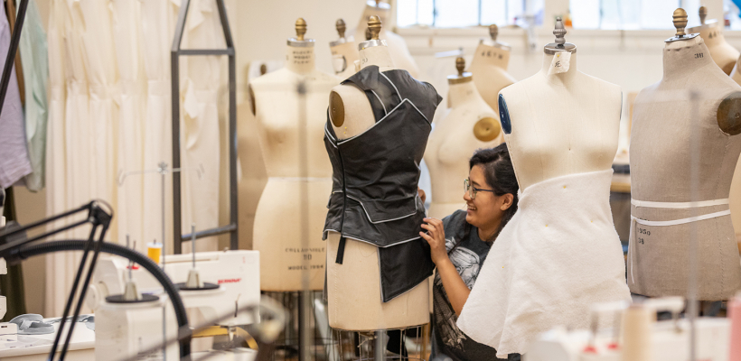 A student works in the School of Drama costume shop | Photo by Corinne Thrash