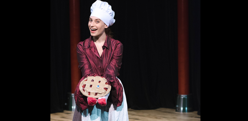Daphne Sage Gonzales holds a pie designed by Props Master Kayleah Lewis for UTS' Complete Works of William Shakespeare (Abridged)