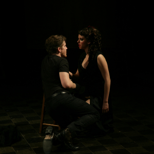 MacHeath shares a romantic moment with one of his three women, Lucy.