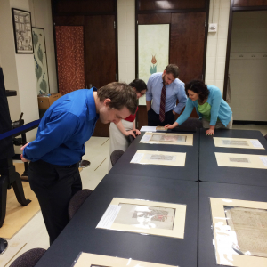 Drama PhD students look at medieval manuscripts in Special Collections.