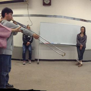 Cathy instructing a trombone player in Japan.