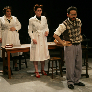 Actors from The Workroom--two female actors in white jackets and a male actor in plaid.