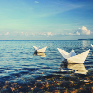 Paper boats on an ocean