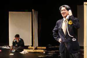 "David Henry Hwang, played by Mikko Juan, left, receives advice from his optimistic father, played by Season Qiu, right, in the new UTS show, ""Yellow Face."" Photo by Johanna Lundahl."