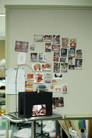 a scene mock up with a wall full of design pictures