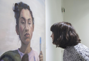 student analyzes a painting
