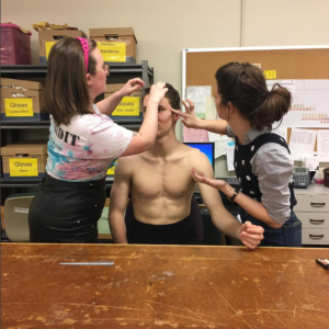 MFA Costume Design students prepare an actor. Photo by Holly Arsenault.