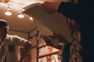 People rehearsing a play with scripts