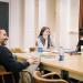 Drama Ph.D. students laugh during a seminar class