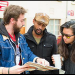 Nathan Wornian, AJ Friday, and Hazel Lozano discuss logistics for performing their theater piece in a U-District alley.