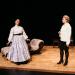 Actors on stage in blackbox theatre